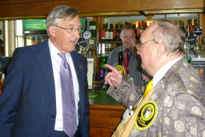 Howling makes his point with Sir Gerald Howarth with barman Will nervously biting his nails in the background